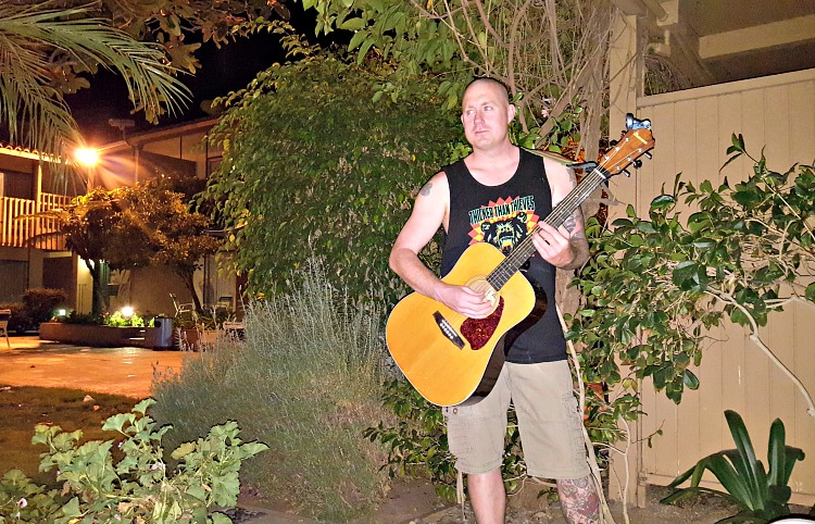 Brian playing guitar on our patio at the Best Western Peppertree Inn