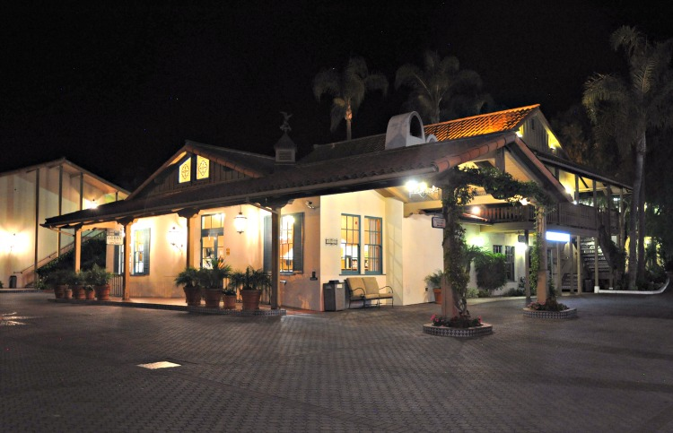 Outside view of the lobby of the Best Western Peppertree Inn at night