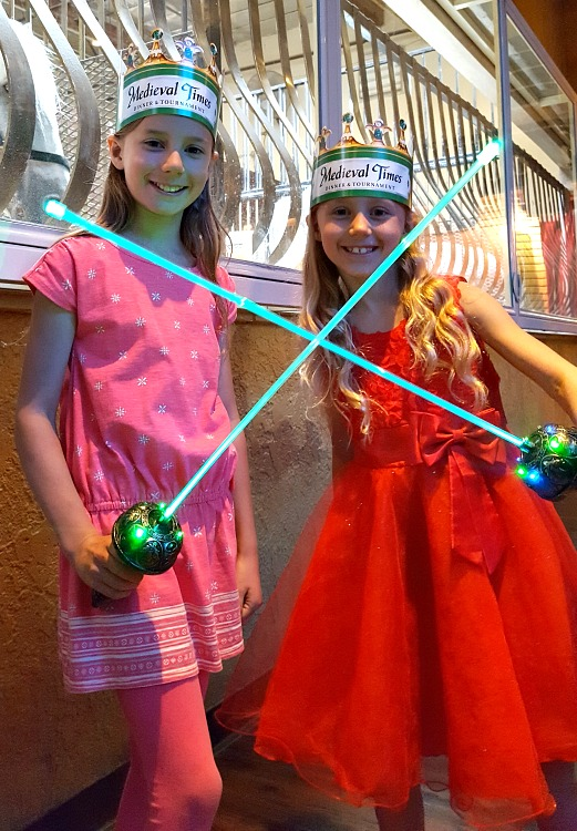 Zoë and Kaylee with light up swords at Medieval Times in Buena Park, CA