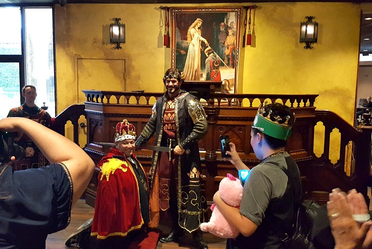 King knighting someone at Medieval Times in Buena Park, CA