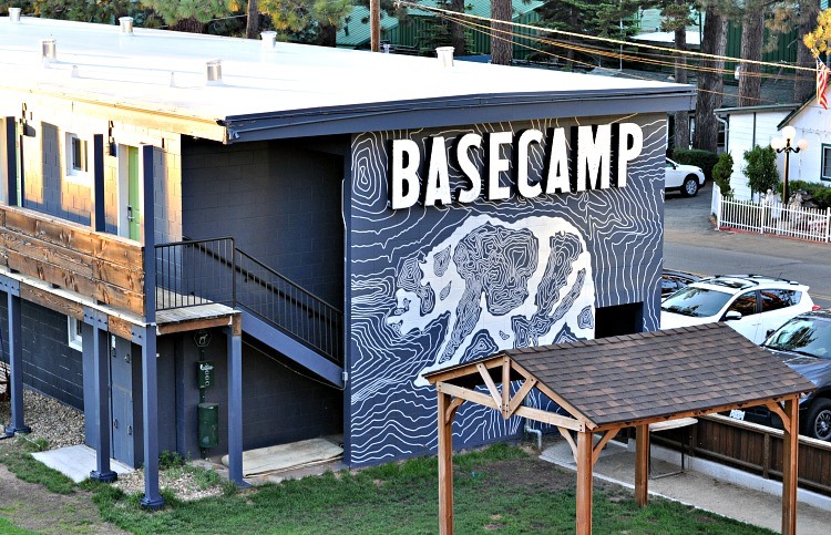 Basecamp sign with painted bear art on hotel