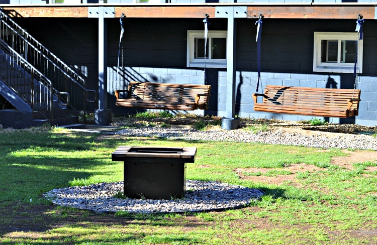 Swings and outdoor fire pit at Basecamp Hotel in Tahoe South
