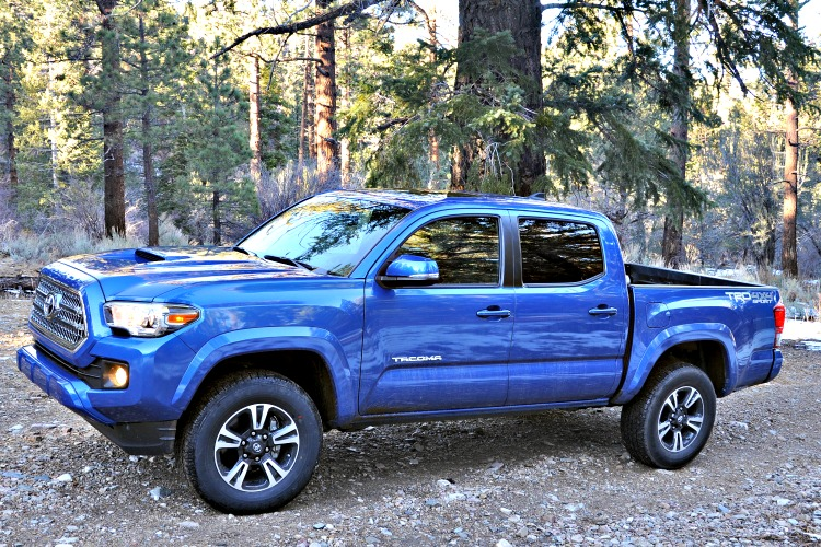 Side view of blue Toyota Tacoma that I took off roading