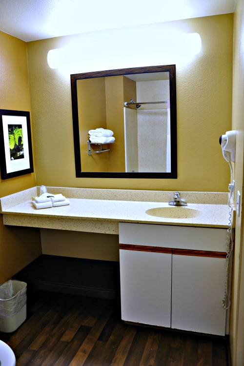 Sink and mirror in Extended Stay America hotel room