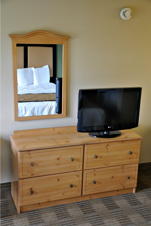 Dresser and TV in Extended Stay America hotel room
