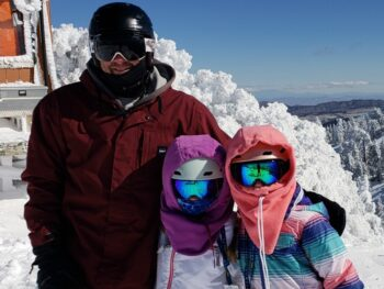 Brian, Zoë and Kaylee snowboarding together