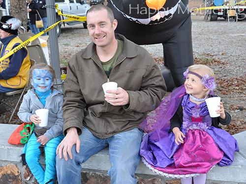 Brian, Zoe and Kaylee drinking hot chocolate on Halloween