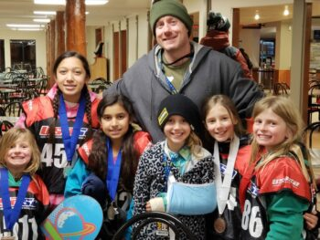 Brian with the girls he coached at USASA Rail Jam