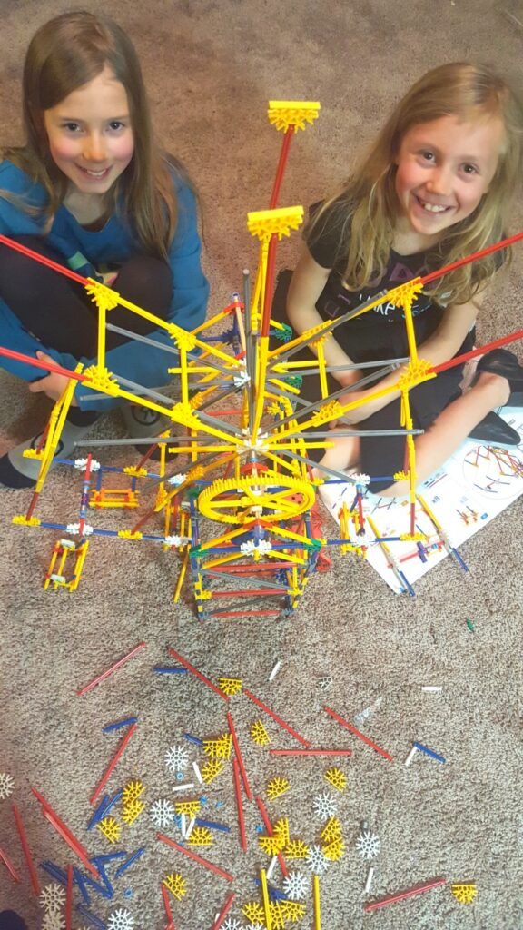 Zoë and Kaylee building a Ferris Wheel