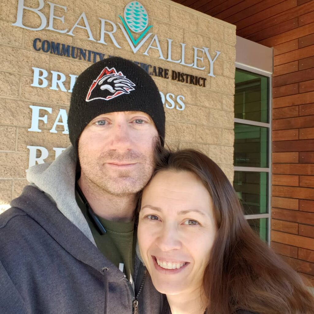 Brian and Chrystal in front of the Family Health Center