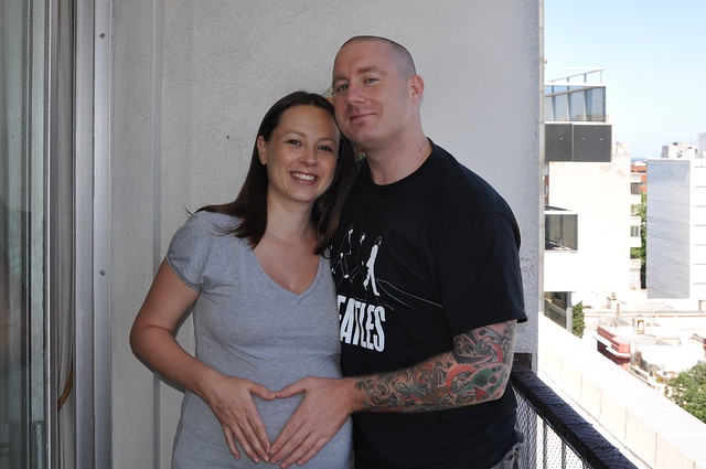 Brian with pregnant Chrystal making a heart over her belly
