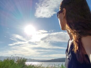 Chrystal gazing at lake after getting health news