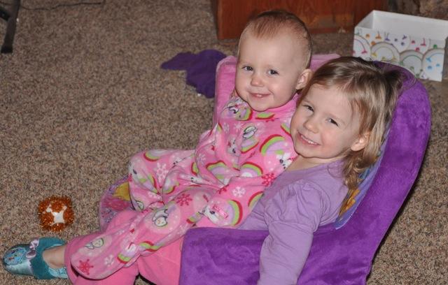 Kaylee sitting in Zoë's lap