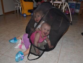 Zoë and Kaylee playing in pop up hamper