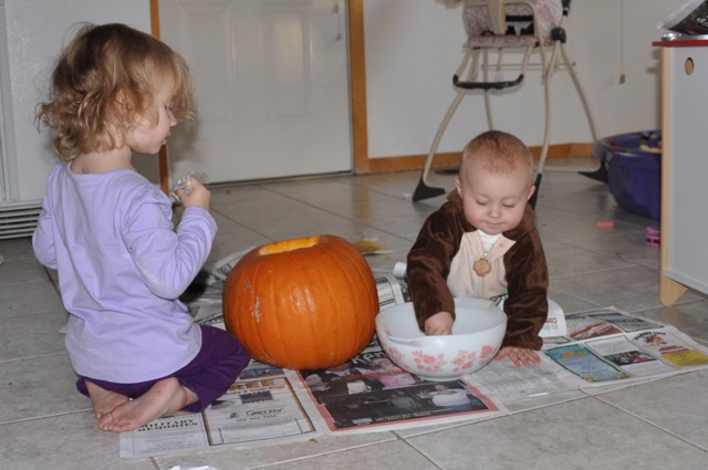 Zoë and Kaylee Seeding the Pumpkin