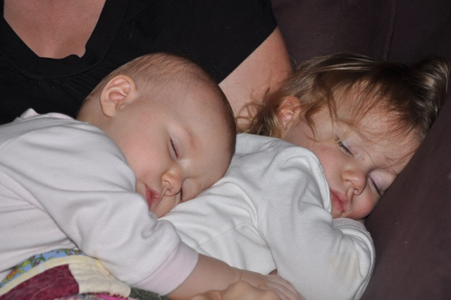 Zoë and Kaylee sleeping together in Chrystal's lap