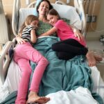 Chrystal, Zoe and Kaylee in a hospital bed in San Diego