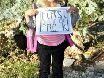 Kaylee holding first day of pre-school sign