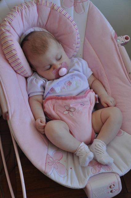 Kaylee sleeping in her pink bouncy seat