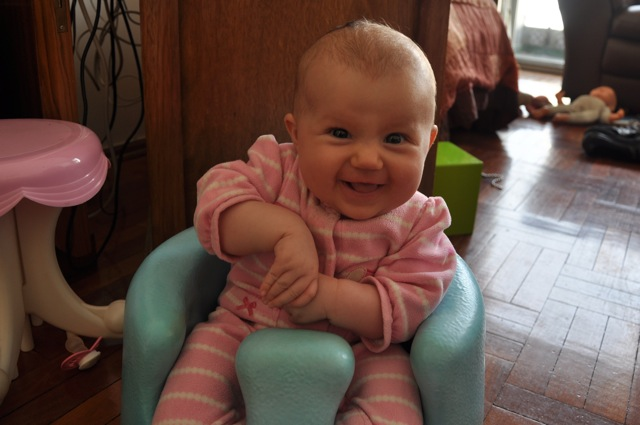 Kaylee smiling in her Bumbo seat