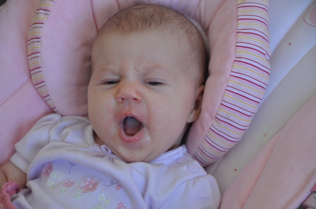 Kaylee yawning in her bouncy chair