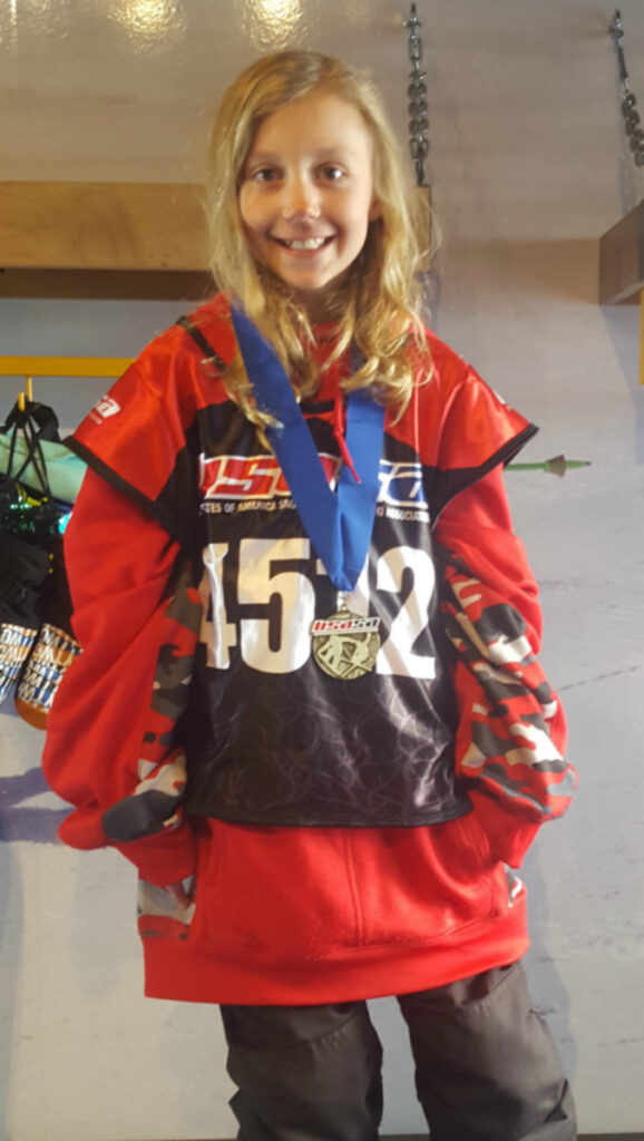 Kaylee with her snowboarding medal
