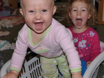 Zoë and Kaylee playing in the laundry basket