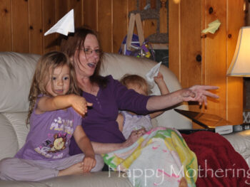 Zoe, Kaylee and Mimi throwing paper airplanes