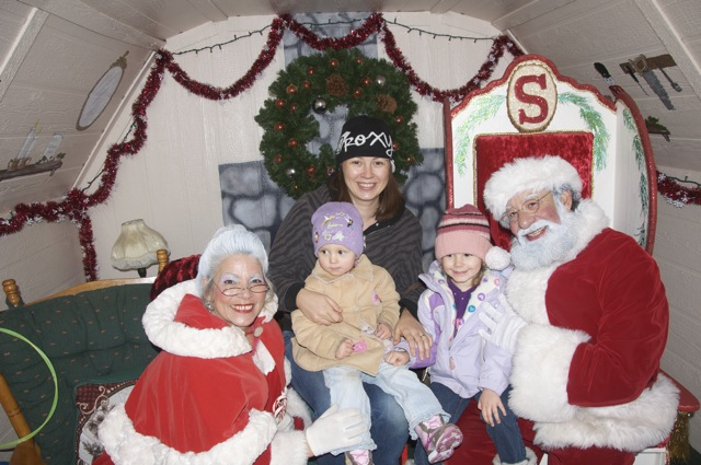 Chrystal with the girls, Santa and Mrs. Claus