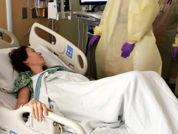 Chrystal laying in a hospital bed in September 2018