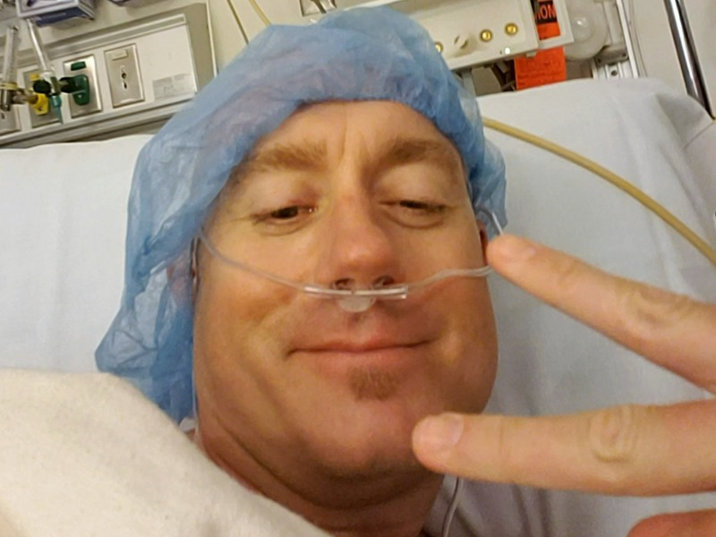 Brian in hospital gown before colonoscopy