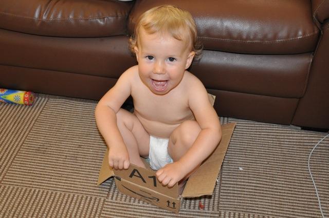 Zoë playing in a box