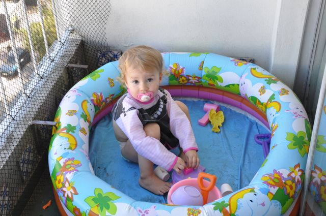 Zoë sitting in empty pool