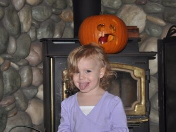 Zoë Showing Off the Pumpkin She Helped Daddy Carve
