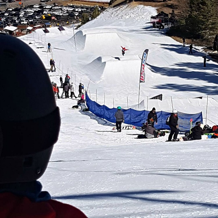 Kaylee watching Zoe on the slopestyle course