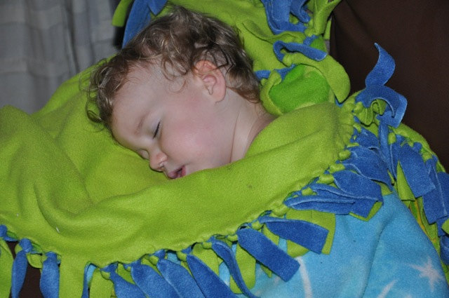 Zoë sleeping wrapped up in her Tinkerbell blanket