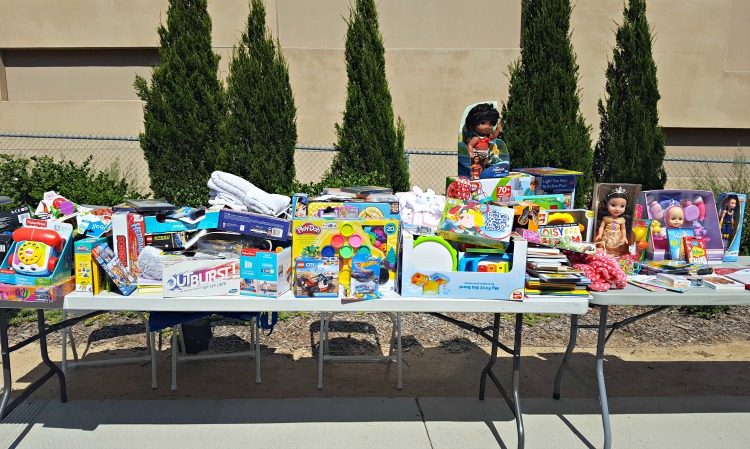 A table of toys to donate to Rady Children's Hospital