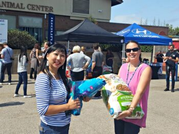 Chrystal and TerriAnn donating pet food to Helen Woodward Animal Hospital in Rancho Santa Fe, CA