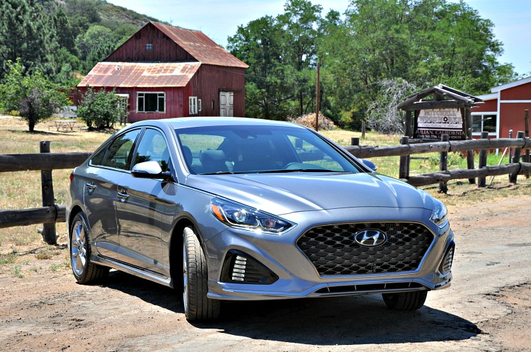 Hyundai Sonata parked in Julian by an old red barn