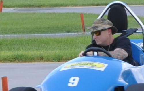 Brian driving a blue car at the Las Vegas Mini Gran Prix