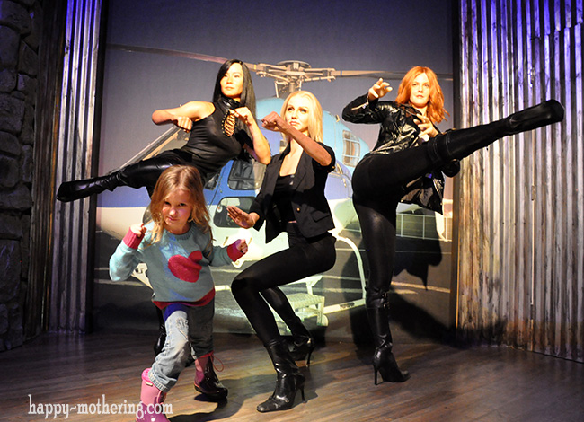 Zoë posing with Charlie's Angels at the Hollywood Wax Museum