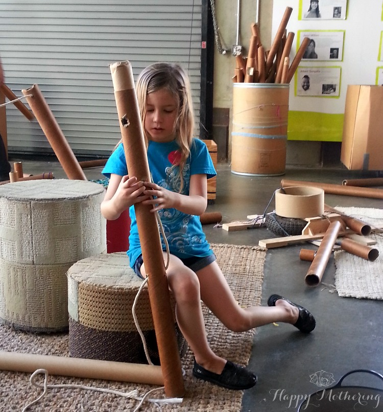Zoë playing with building tubes at the San Diego Children's Museum