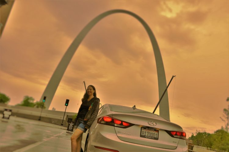 Chrystal standing by the Elantra Eco in front of the St. Louis arch