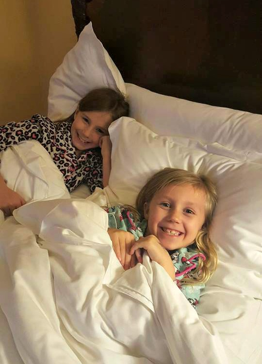 Zoë and Kaylee in their bed at the Four Seasons Westlake Village
