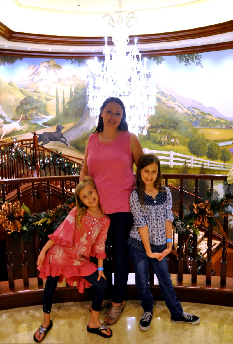 Chrystal, Zoë and Kaylee in front of a chandelier at the Four Seasons Westlake Village