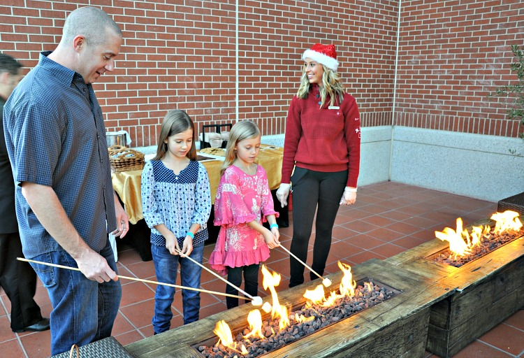 Brian, Zoë and Kaylee roasting marshmallows at the Four Seasons Westlake Village Let It Snow Event