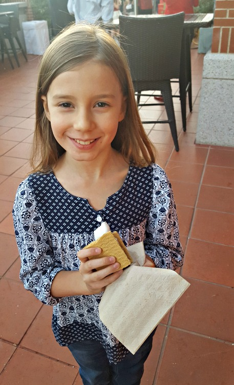 Zoë eating a S'more at the Four Seasons Westlake Village Let It Snow Event