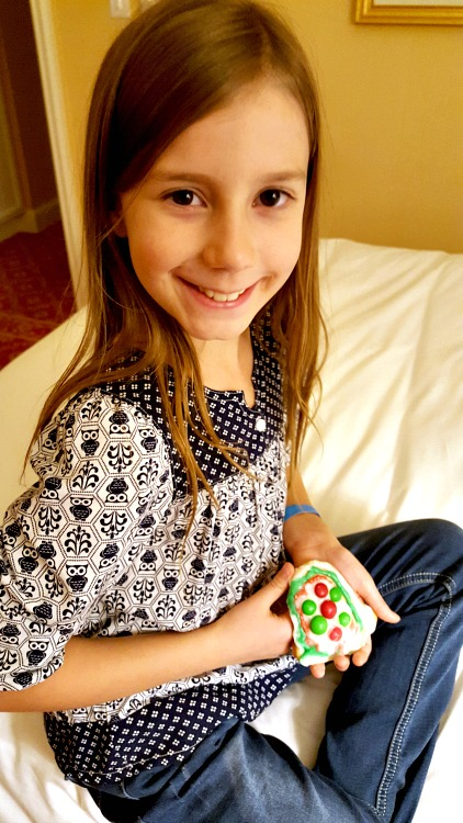 Zoë holding the cookie she decorated