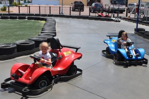 Girls driving cars at the Las Vegas Mini Gran Prix