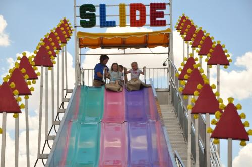 Girls going down slide at Las Vegas Mini Gran Prix